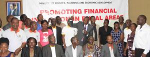 State Minister for Microfinance Hon. Haruna Kyeyune Kasolo(with a microphone) during the launch of service providers in Soroti